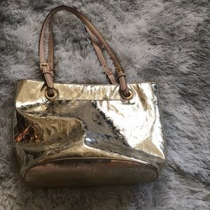gold Michael Kors purse barley used